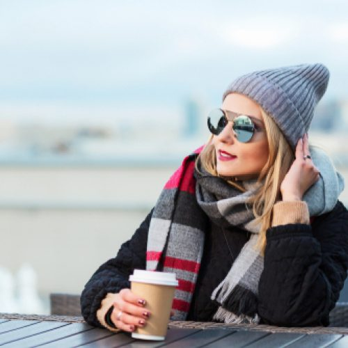 Woman with sunglasses and coffee
